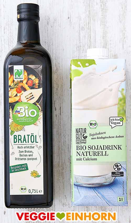 Eine Flasche dm Bio Bratöl und eine Packung Naturgut Bio Sojadrink Naturell