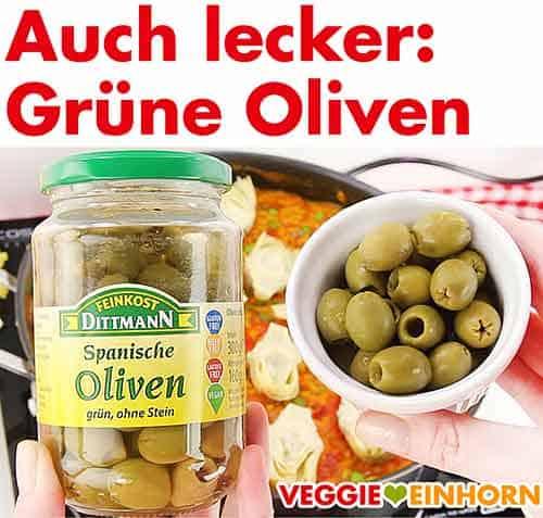 Ein Glas grüne Oliven