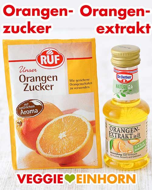Ein Päckchen Orangenzucker und ein Fläschchen Orangenextrakt
