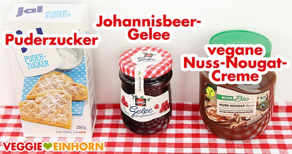 Puderzucker, Johannisbeergelee und vegane Nuss-Nougat-Creme