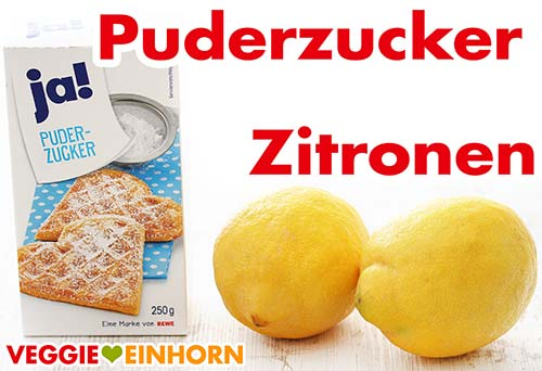Eine Packung Puderzucker und zwei Zitronen