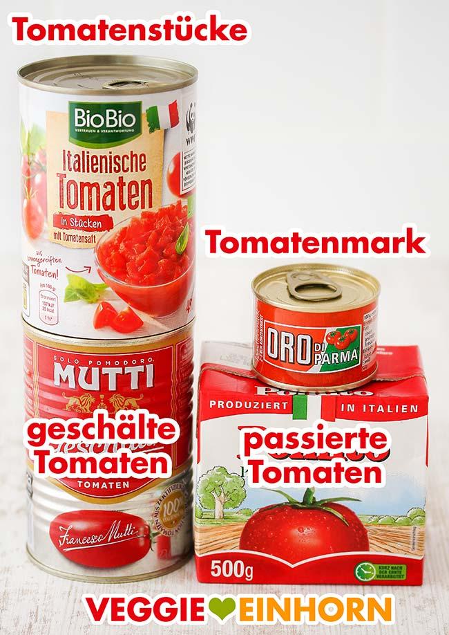 Dosentomaten, eine Dose Tomatenmark und ein Tetrapack mit Passata