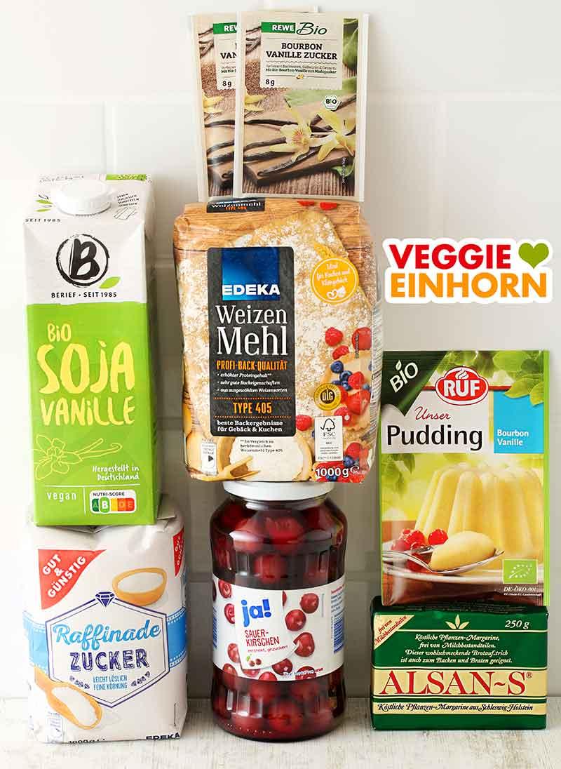 Sojamilch Vanille, Vanillezucker, Weizenmehl Type 405, Zucker, ein Glas Sauerkirschen, ein Päckchen RUF Puddingpulver, Alsan-S Margarine