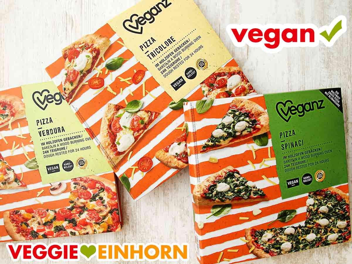 Drei Packungen mit Veganz Pizza