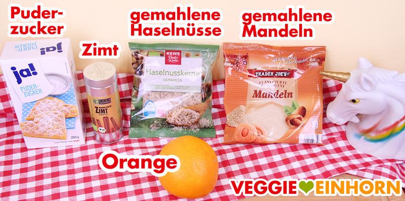 Puderzucker, Zimt, gemahlene Haselnüsse und Mandeln, Orange