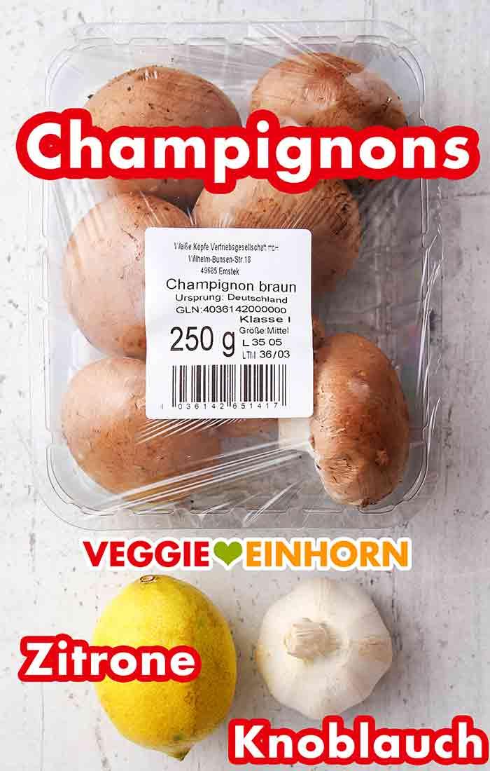 Frische Champignons, Zitrone, eine Knolle Knoblauch
