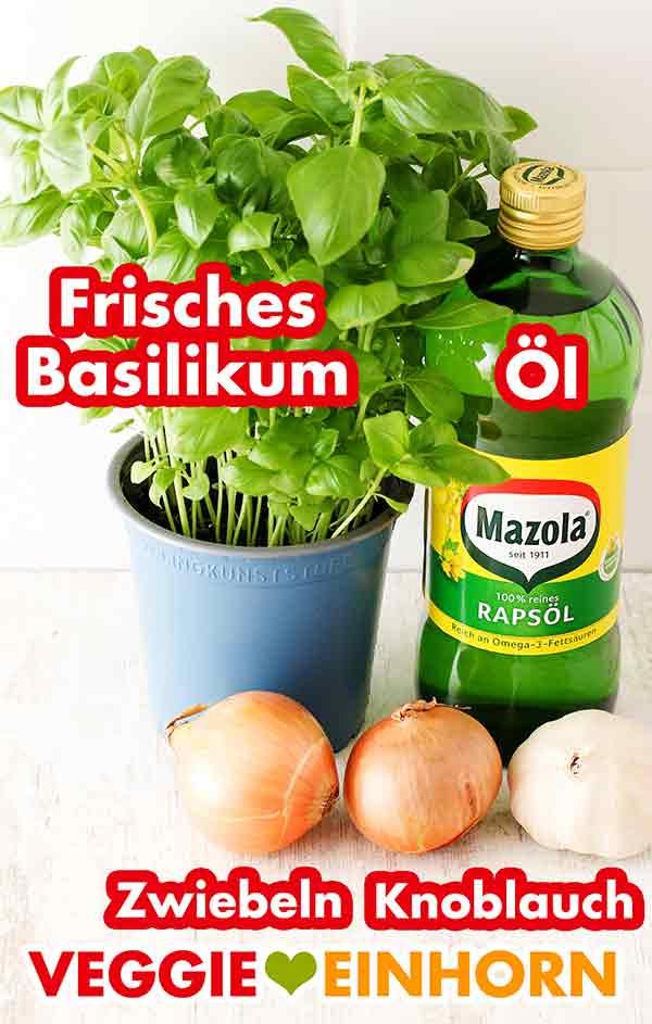 Ein Topf Basilikum, eine Flasche Öl, Zwiebeln, Knoblauch