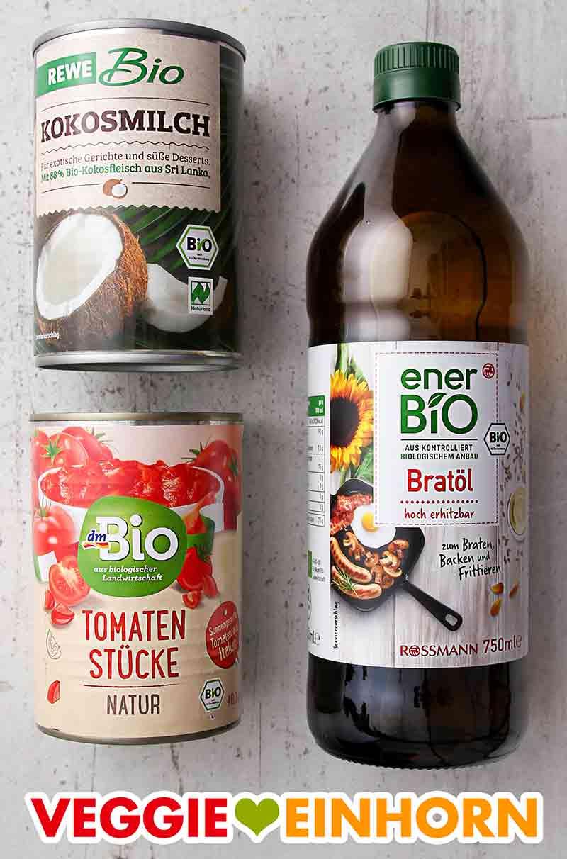 Kokosmilch, eine Dose Tomaten, eine Flasche Pflanzenöl