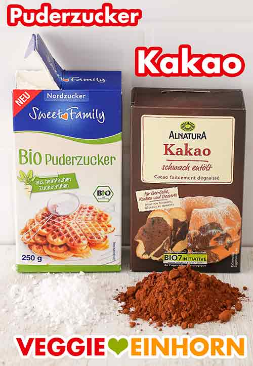 Eine Packung Puderzucker und eine Packung Kakaopulver