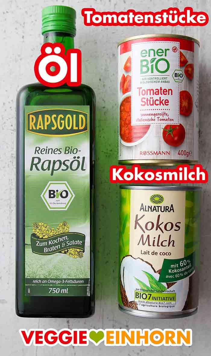 Eine Flasche Bio Rapsöl, eine Dose Tomatenstücke und eine Dose Kokosmilch
